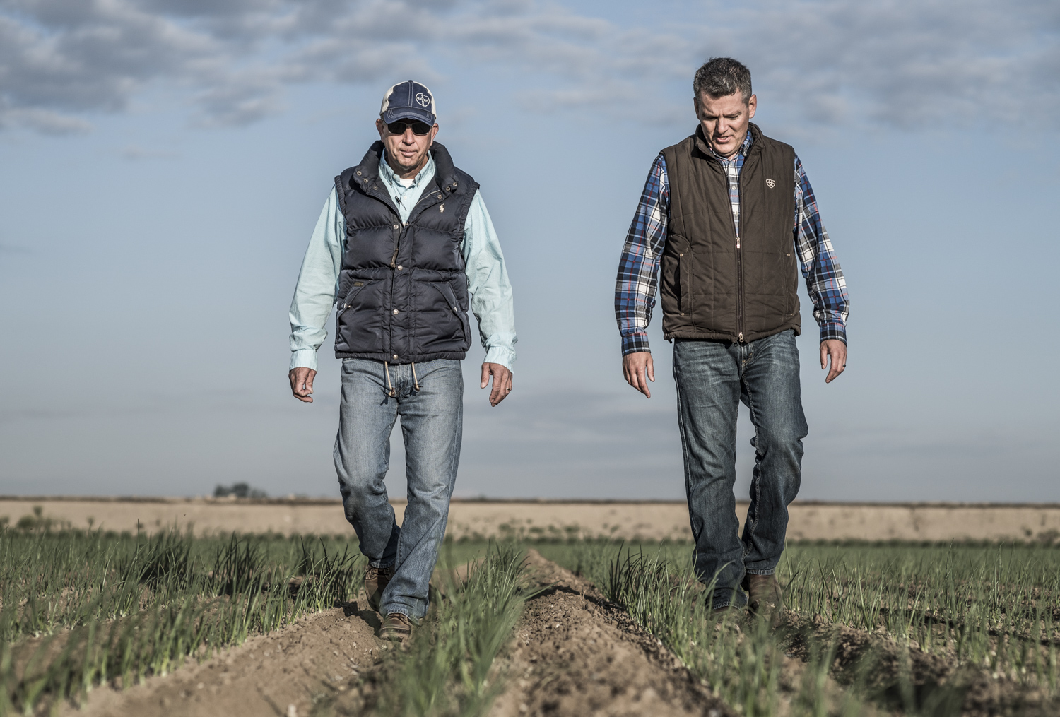 Farmers walking in field
