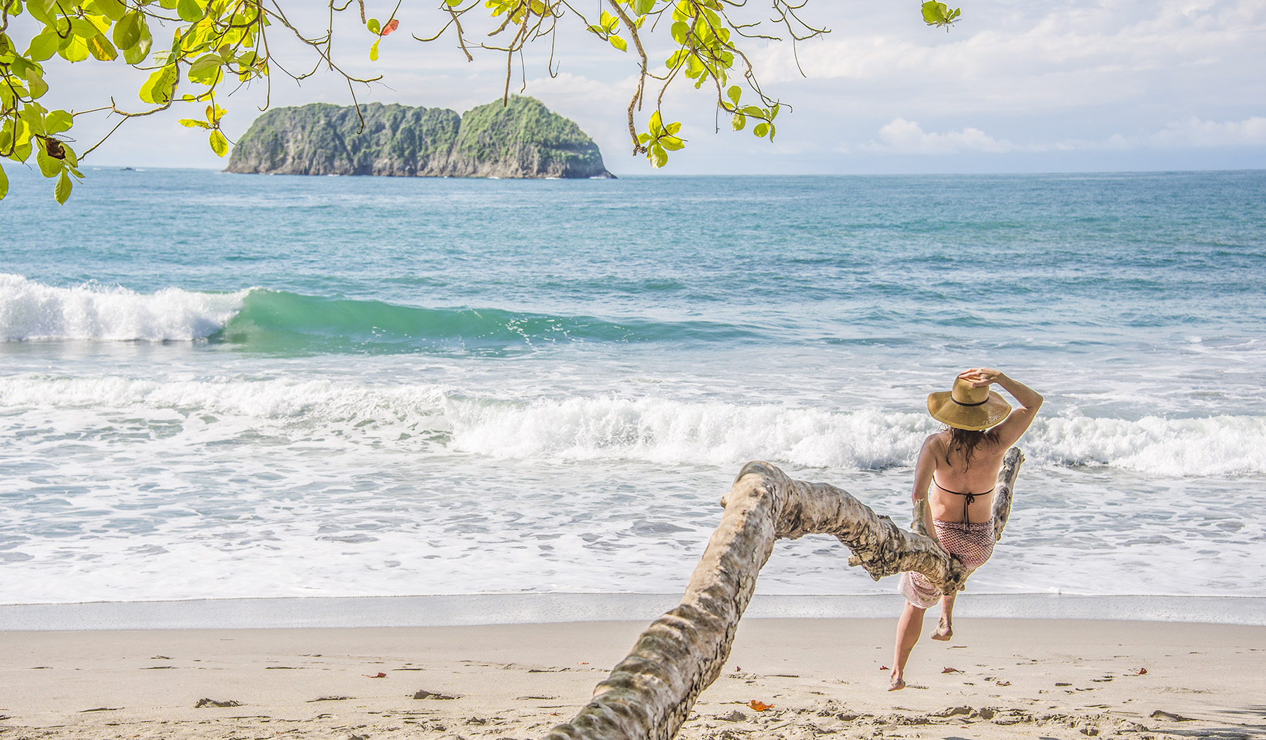 Costa Rica beach and woman with hat